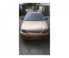 Hyundai Accent automático 2004 color dorado