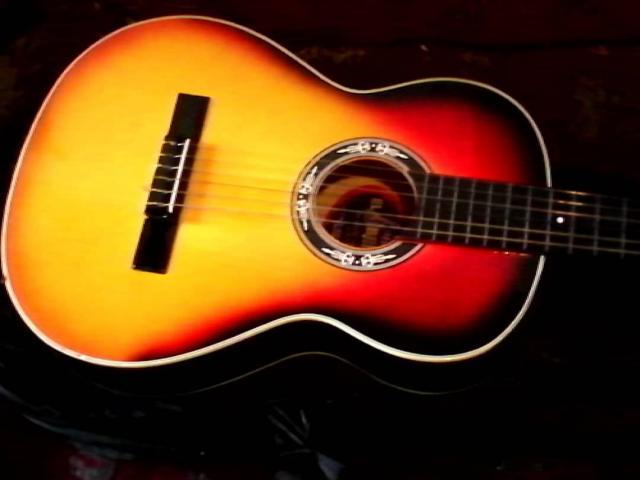 guitarra con acabado colombiano en su forro como nueva - 2/3