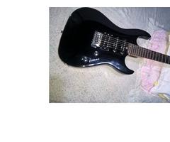 Guitarra Electrica Washburn PRO X Series modelo X 10, con estuche y un cable.